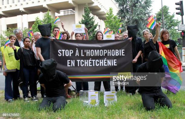 Amnesty International militants hold a banner reading 'Stop homophobia in Chechnya' to denounce persecution against LGBT community in Chechnya on...