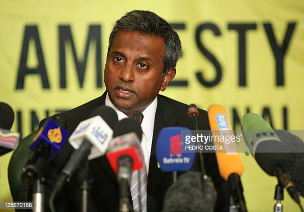 Amnesty International secretary general Salil Shetty speaks during a press conference at the journalists' syndicate in the Egyptian capital Cairo on...