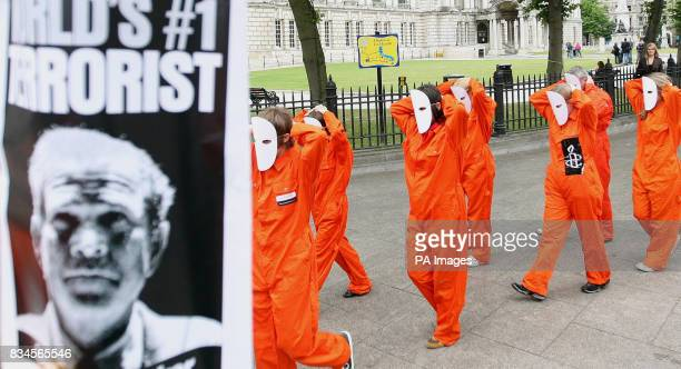 Amnesty International stage a demonstration to voice concerns about prisoner treatment and the detention of terror suspects through the streets of...