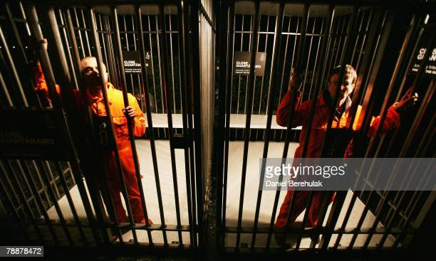 Amnesty International supporters wearing orange boiler suits hold a night long vigil in a cage outside of the US embassy on January 10 2008 in London...
