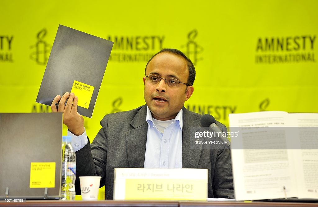 Amnesty's East Asia Researcher Rajiv Narayan holds up a research booklet as he speaks during a press conference on South Korea's security law in Seoul on November 29, 2012. Amnesty International accused South Korea of systematically abusing a 65-year-old security law in order to stifle debate and silence political opposition in Asia's fourth-largest economy.
