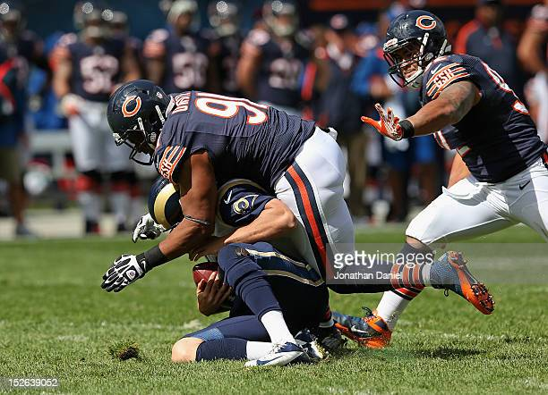 Amobi Okoye of the Chicago Bears sacks Sam Bradford of the St Louis Rams as Stephen Paea closes in at Soldier Field on September 23 2012 in Chicago...