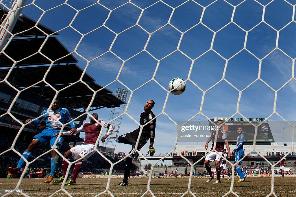 Amobi Okugo #14 of the Philadelphia Union heads the ball in for a goal past Marvell Wynne #22 and goalkeeper Matt Pickens #18 of the Colorado Rapids during the first half at Dick's Sporting Goods Park on March 10, 2013 in Commerce City, Colorado.