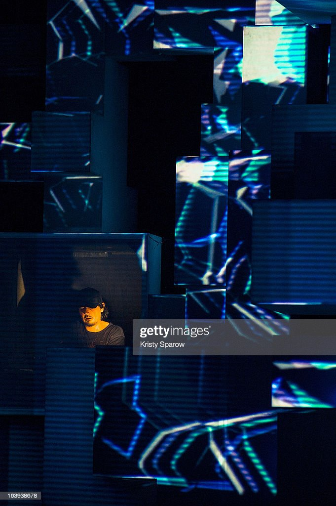 <a gi-track='captionPersonalityLinkClicked' href=/galleries/search?phrase=Amon+Tobin&family=editorial&specificpeople=5296110 ng-click='$event.stopPropagation()'>Amon Tobin</a> preforms ISAM live onstage for the last performance after the world tour at the Grande Halle De La Villette on March 13, 2013 in Paris, France.