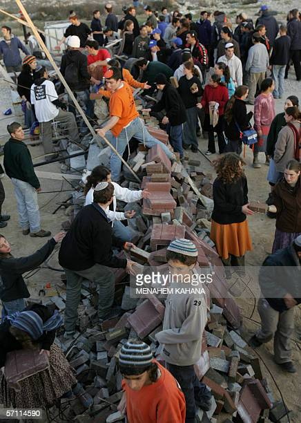 Israeli settlers stack a barrier as they hunker down prior to the army's planned destruction of nine houses in the Amon settlement in the West Bank...