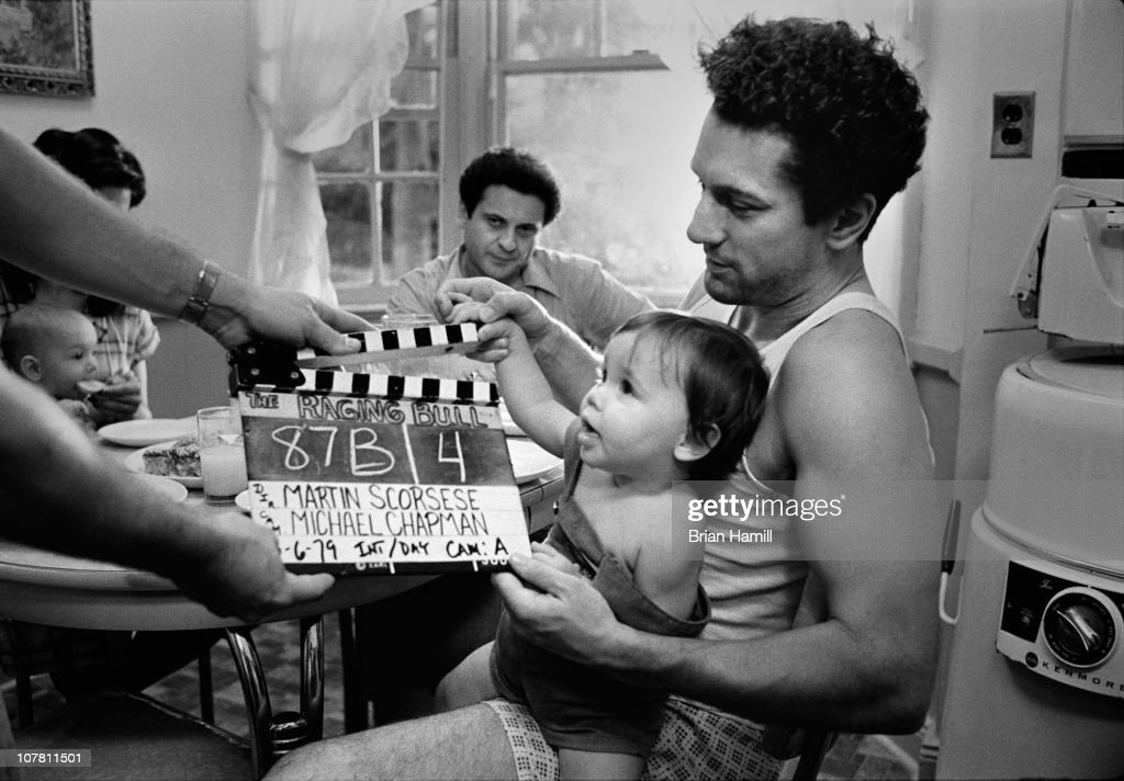 Among others, American actors Robert De Niro (right), as boxer Jake La Motta, and Joe Pesci (center, rear), as Joey La Motta, prepare for a scene from the Martin Scorsese-directed film 'Raging Bull,' 1980.
