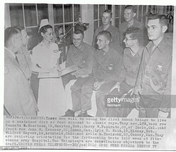 Among the first human beings to attempt to live on a sustained diet of food exposed to atomic rays these conscientious objectors to the draft receive...