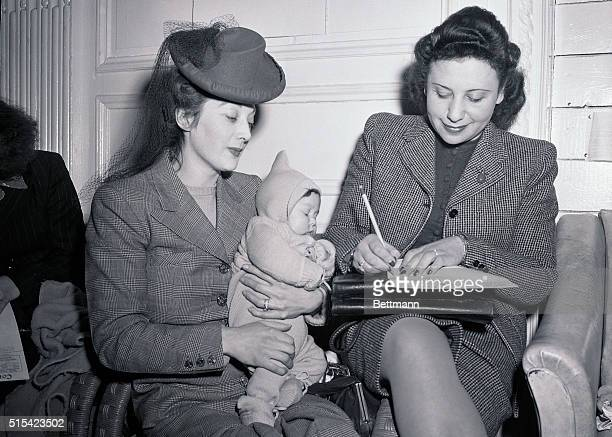 Among the G I brides and babies arriving aboard the 'Stork Transport' USS Argentina which docked in New York on February 4th were Mrs Joy V Barrie...