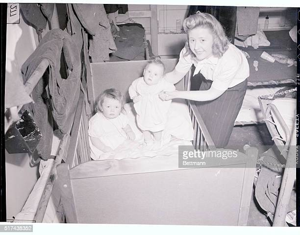 Among the G I 'war Brides' and babies arriving in New York aboard the 'stork transport' USS Argentina on February 4th were Mrs Winifred M Genyn and...