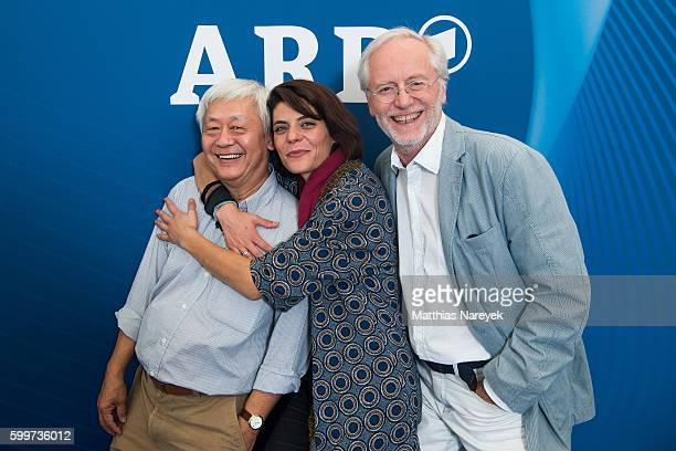 Amorn Surangkanjanajai Sara Turchetto and Joachim H Luger visit the ARD stand at 2016 IFA tech fair on September 6 2016 in Berlin Germany