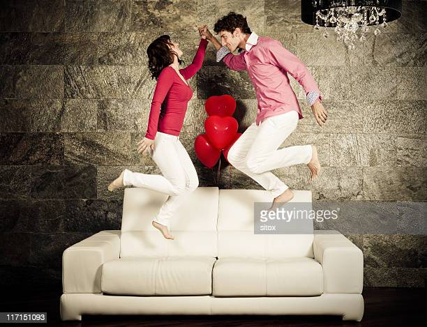 Amorous couple having fun on a sofa