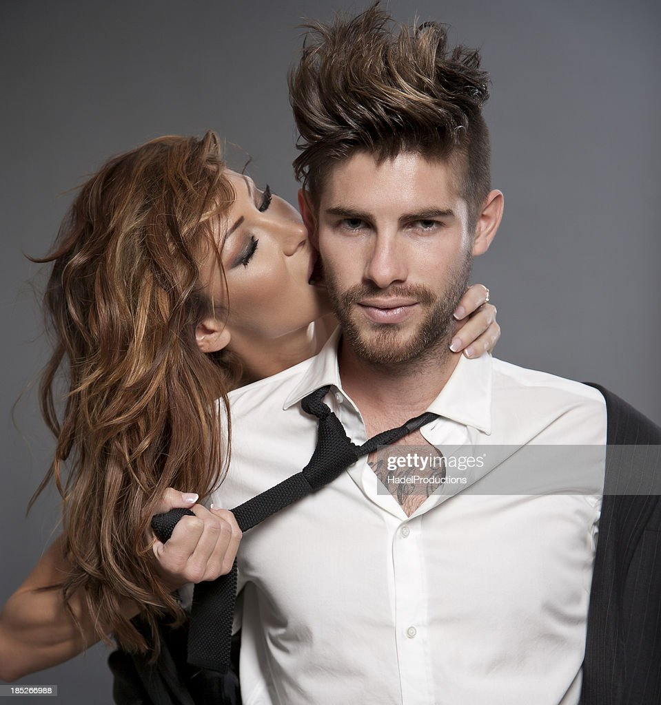 Amorous Couple on grey background : Stock Photo