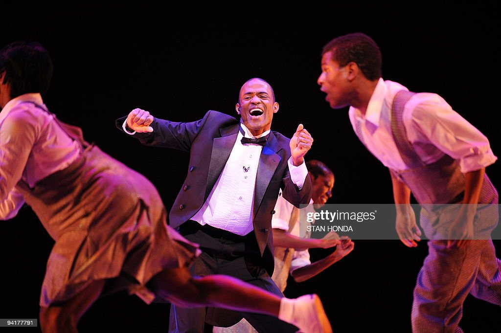 Amos J. Machanic, Jr. (C) of the Alvin Ailey American Dance Theater during dress rehearsal of 'Uptown', chorographed by Matthew Rushing, December 9, 2009 in New York. The performance highlights key events of the Harlem Renaissance era in the 1920's. AFP PHOTO/Stan Honda