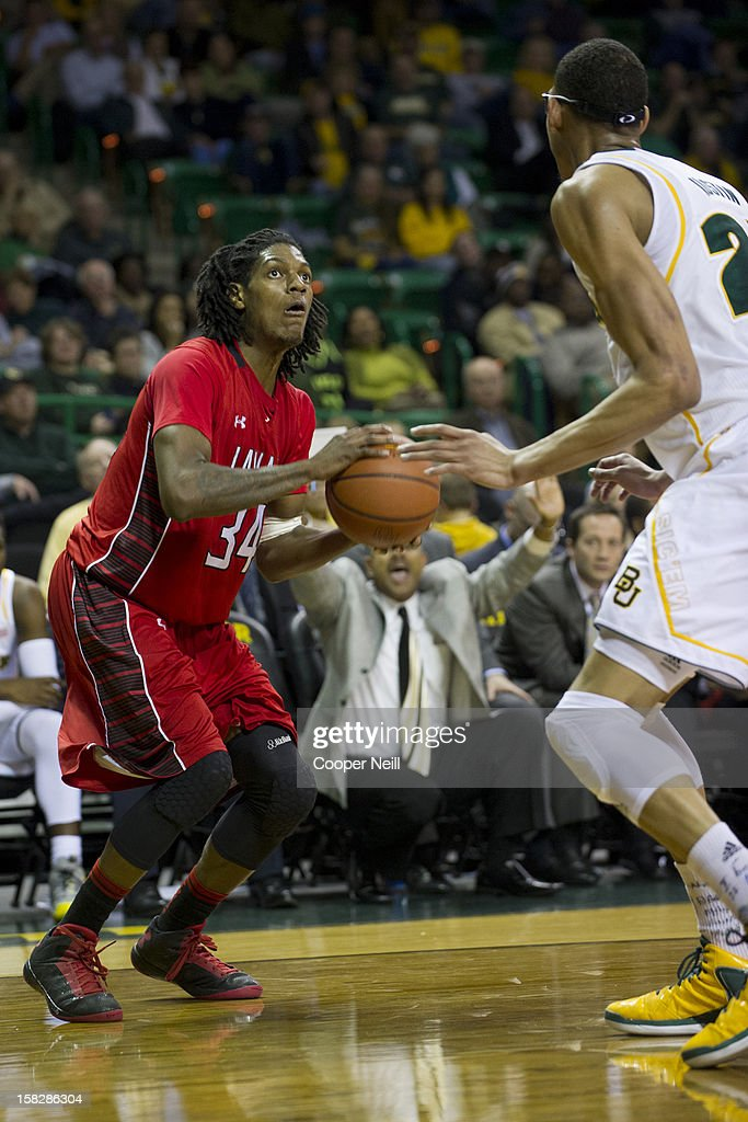 Amos Wilson #34 of the Lamar Cardinals shoots the ball against the Baylor University Bears on December 12, 2012 at the Ferrell Center in Waco, Texas.