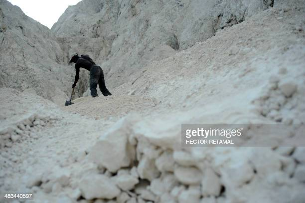 Amos works at the sand mine in La Boule 12 Petion Ville Port au Prince on April 8 2014 He earns about 350 Gourdes some eight US dollars per day The...
