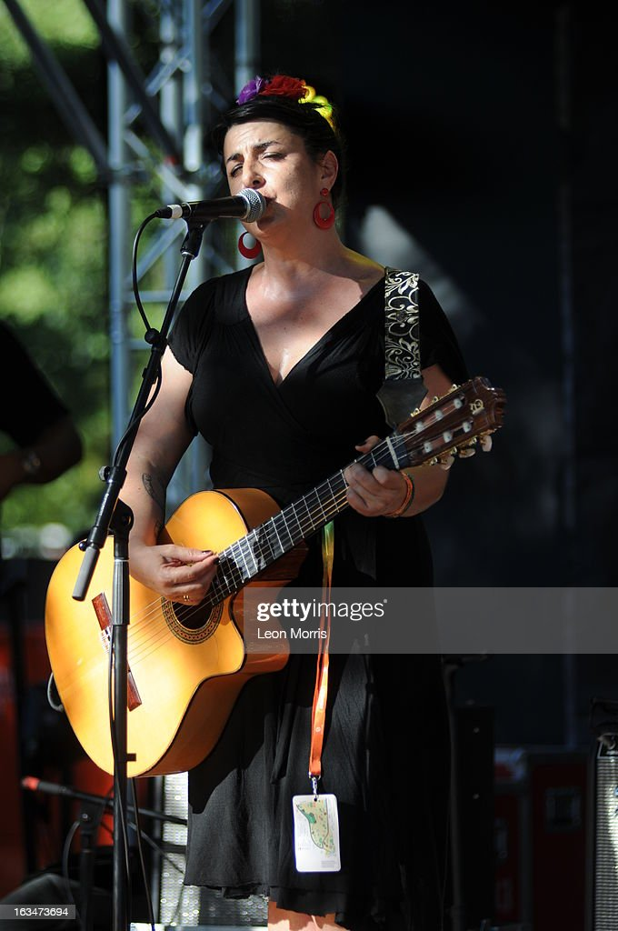 <a gi-track='captionPersonalityLinkClicked' href=/galleries/search?phrase=Amparo+Sanchez&family=editorial&specificpeople=6844116 ng-click='$event.stopPropagation()'>Amparo Sanchez</a> performs on stage at Womadelaide 2013 at Botanic Park on March 10, 2013 in Adelaide, Australia.