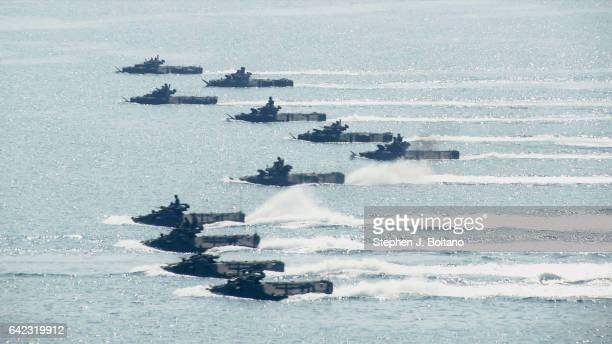 SATTAHIP CHONBURI THAILAND Amphibious assault vehicles approach the beach head during the ongoing USThai joint military exercise titled 'Cobra Gold'...