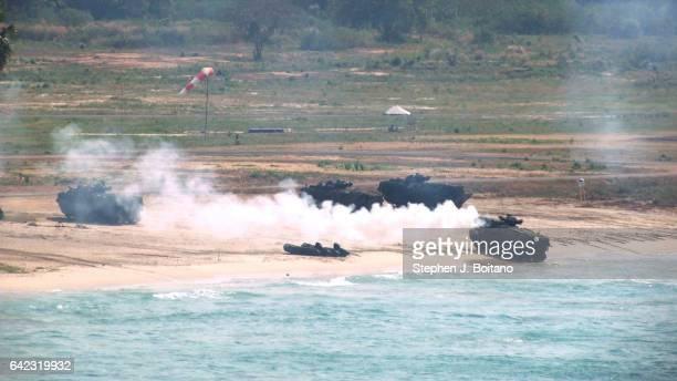 SATTAHIP CHONBURI THAILAND Amphibious assault vehicles land on the beach head during the ongoing USThai joint military exercise titled 'Cobra Gold'...