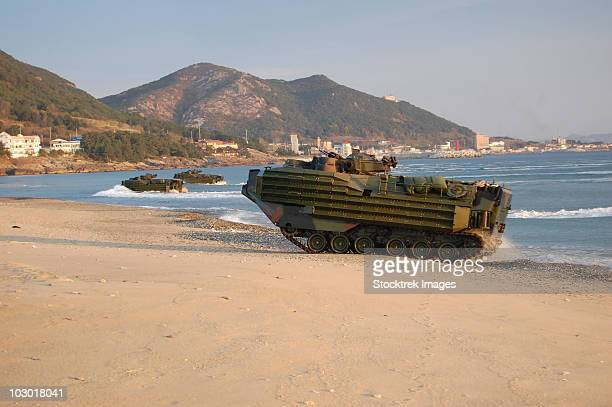 Amphibious assault vehicles push through the sand of Hwajin Beach, Republic of Korea.
