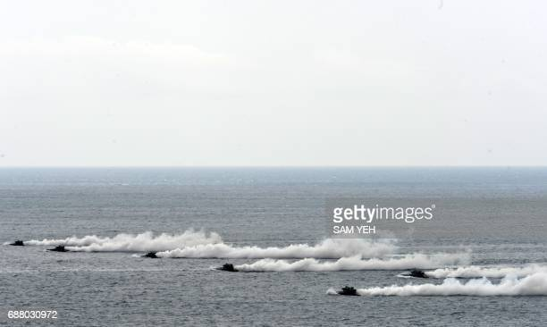 Amphibious assault vehicles release smoke during the 'Han Kuang' lifefire drill some 7 kms from the city of Magong on the outlying Penghu islands on...