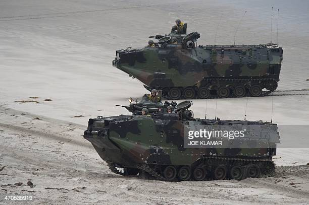 Amphibious Assault Vehicles with 3rd Assault Amphibian Battalion land with US Marines from 1st Battalion 1st Marine Regiment during the US JAPAN...