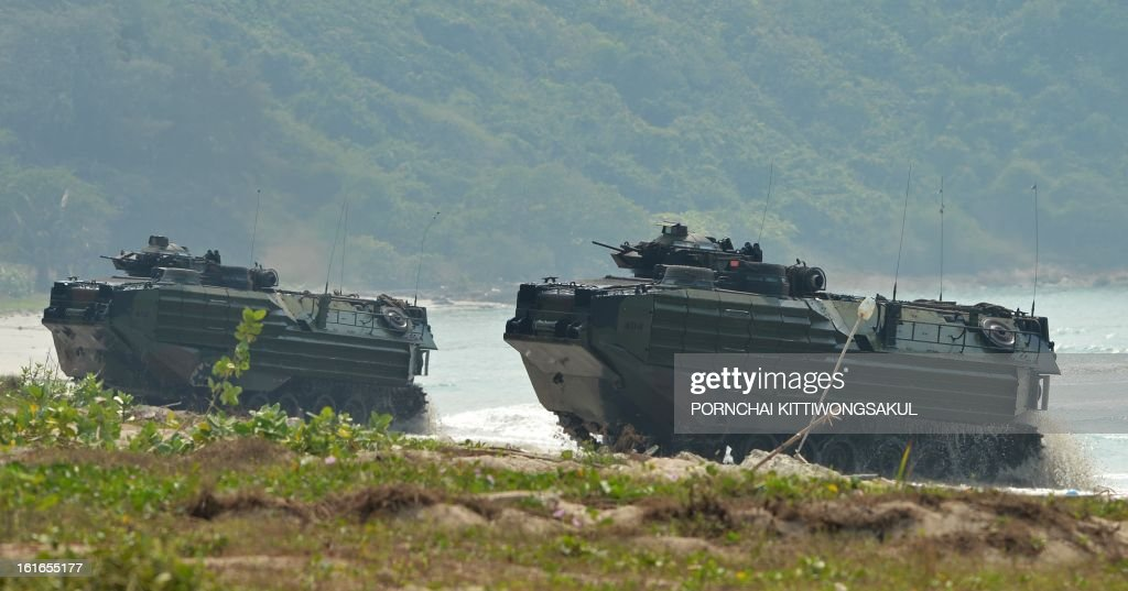 US amphibious attack vehicles (AAVs ) participate in a military drill as part of the annual combined military exercise Cobra Gold 2013 at a Navy base in Sattahip, Thailand's Chonburi province on February 14, 2013. Cobra Gold is a joint, multinational military training exercise that focuses on maintaining and improving military-to-military relationships among nations sharing common goals and security commitments in the Asia-Pacific region including the US, Thailand, Singapore, Indonesia, Japan, Republic of Korea and Malaysia.
