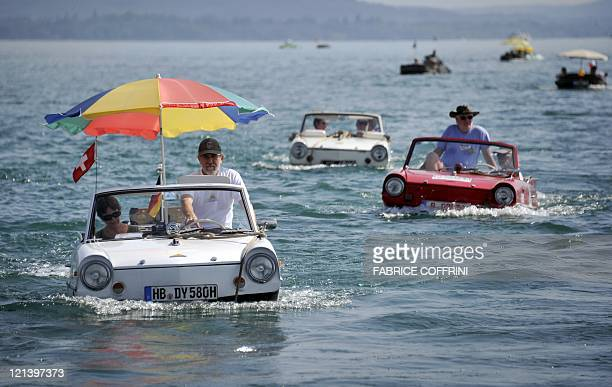 Amphibious cars motor across Lake Neuchatel on August 18 2011 near SaintBlaise during the 26th meeting of amphibious car This week owners of more...