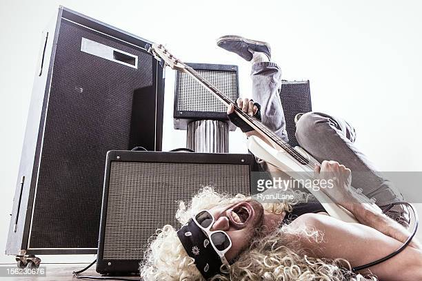 Amps and Rocking Out Bass Guitar Player