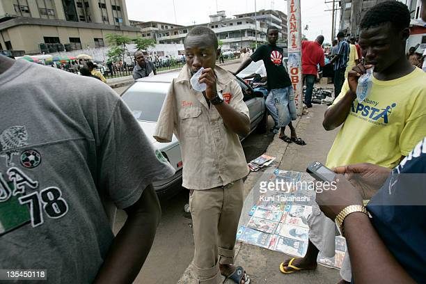 Amputee football player Joseph Allen sells DVDs on the street May 2 2008 in Monrovia Liberia Although the Liberian National team won the 2008 All...