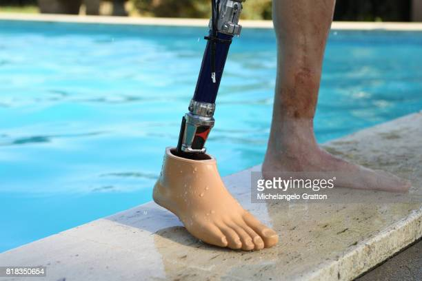 Amputee man in a swimming pool