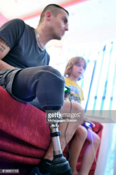 Amputee man playing with young boy