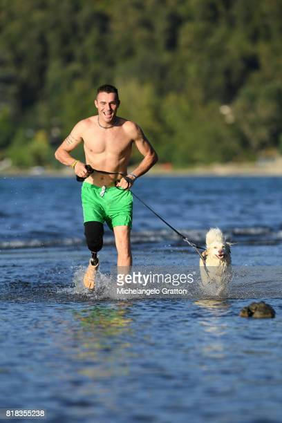 Amputee man running with his dog