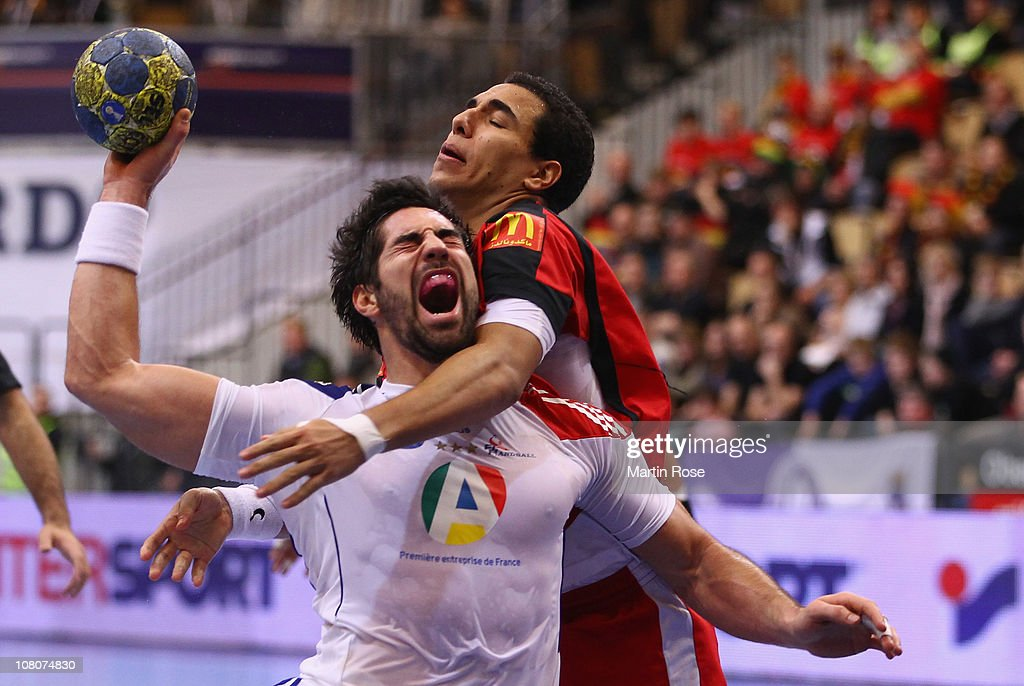 Amr El Kaioby (back) of Egypt is challenged by <a gi-track='captionPersonalityLinkClicked' href=/galleries/search?phrase=Nikola+Karabatic&family=editorial&specificpeople=620415 ng-click='$event.stopPropagation()'>Nikola Karabatic</a> (front) of France during the Men's Handball World Championship Group A match between Egypt and France at Kristiantad Arena on January 16, 2011 in Kristianstad, Sweden.