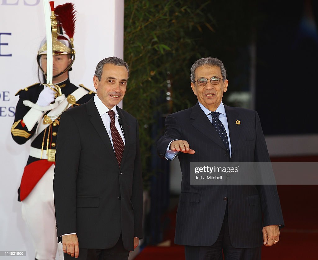 <a gi-track='captionPersonalityLinkClicked' href=/galleries/search?phrase=Amr+Moussa&family=editorial&specificpeople=213955 ng-click='$event.stopPropagation()'>Amr Moussa</a> (R), Secretary General of the League of Arab States, arrives at day two of the G8 Summit May 27, 2011 in Deauville, France. The Tunisian Prime Minister, Beji Caid el Sebsi, and Egyptian Prime Minister, Essam Sharaf, are due to meet with G8 leaders today to discuss aid packages as the recent Arab Spring uprisings continue to dominate the talks. Furthermore, the meeting will address security, trade issues, nuclear safety and climate change.