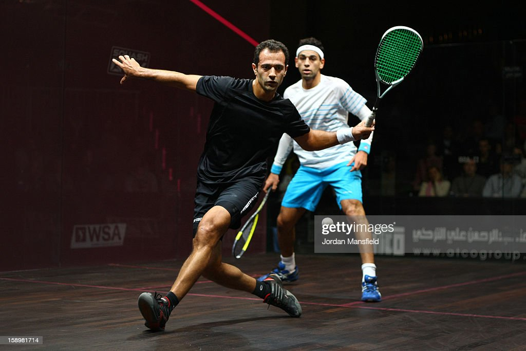 Amr Shabana of Egypt in action against Mohamed El Shorbagy of Egypt during Day 3 of the ATCO World Series Squash Finals played at Queens Club on January 4, 2013 in London, England.