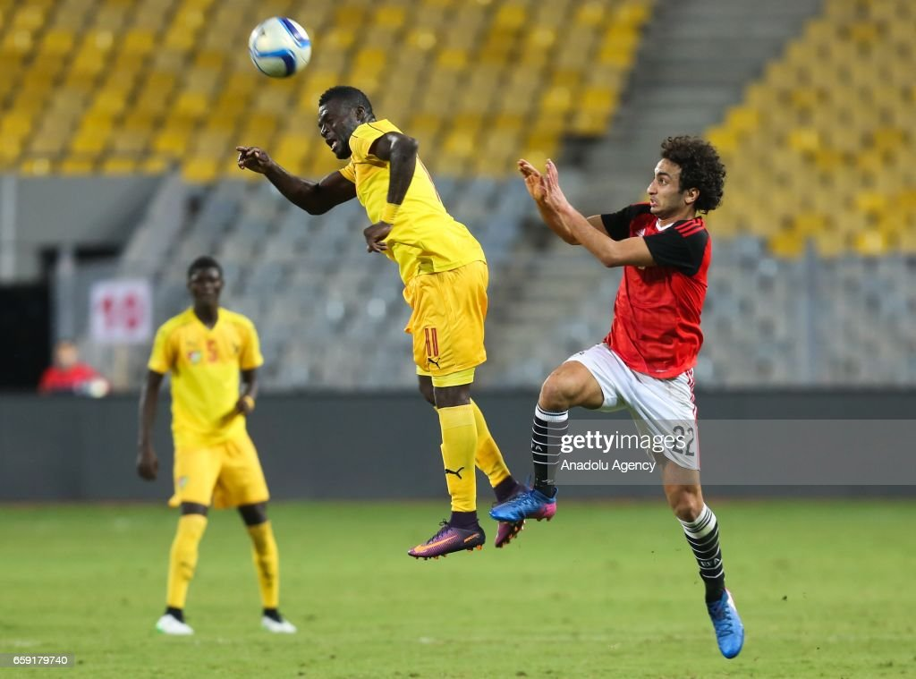 Amr Warda (R) of Egypt in action against Maklibe Kouloum (L) of Togo during the friendly football match between Egypt and Togo at Borg El Arab Stadium in Alexandria, Egypt on March 28, 2017.