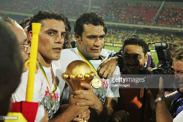 Amr Zaki and Essam ElHadary celebrate with the winners' trophy following Egypt's victory of the AFCON Final match between Cameroon and Egypt at the...