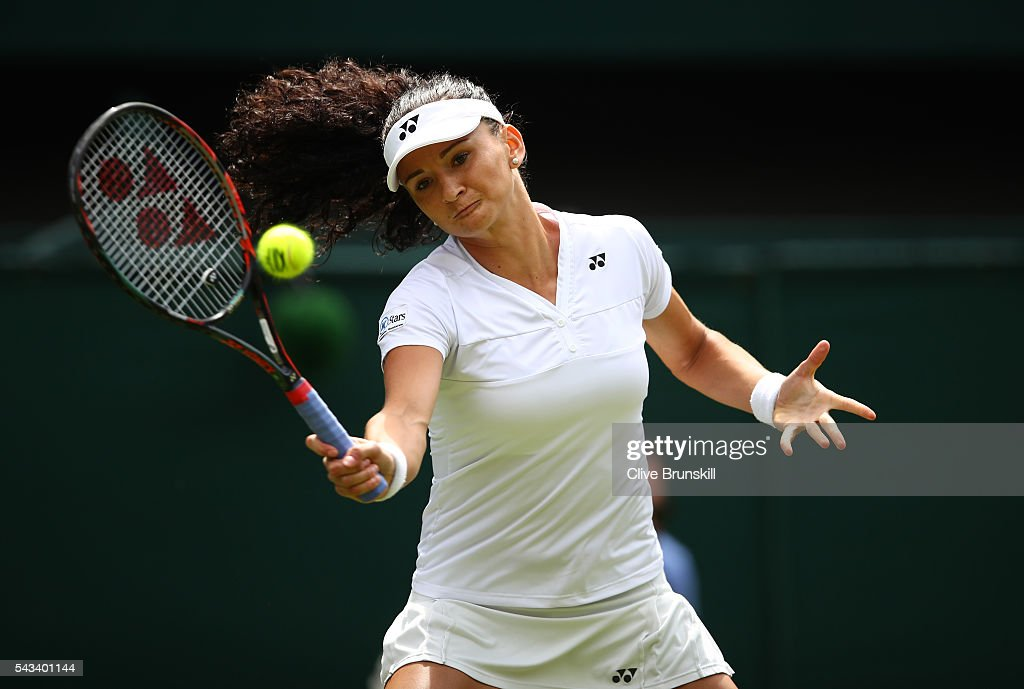 Amra Sadikovic of Switzerland plays a forehand during the LadiesSingles first round match against Serena Williams of The United States on day two of the Wimbledon Lawn Tennis Championships at the All England Lawn Tennis and Croquet Club on June 28, 2016 in London, England.