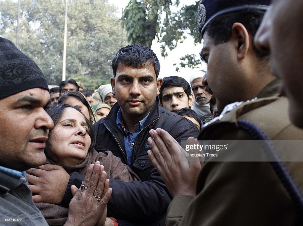 Amrish, wife of Delhi Police constable Subhash Chand Tomar being condole by a police official during funeral rites of her husband at Nigambodh Ghat, on December 25, 2012 in New Delhi, India. Subhash Chand died after being injured in a protest against brutal gang rape of a student in a moving bus.