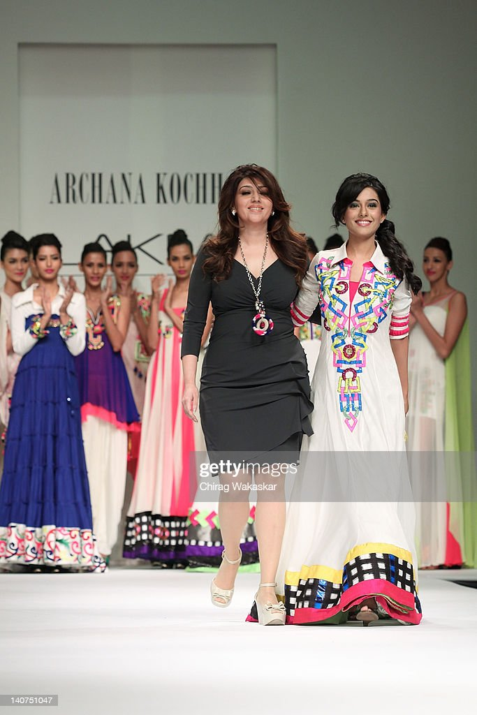 <a gi-track='captionPersonalityLinkClicked' href=/galleries/search?phrase=Amrita+Rao&family=editorial&specificpeople=3080005 ng-click='$event.stopPropagation()'>Amrita Rao</a> (R) walks the runway with designer Archana Kochhar (L) at Lakme Fashion Week Summer/Resort 2012 day 5 at the Grand Hyatt on March 6, 2012 in Mumbai, India.