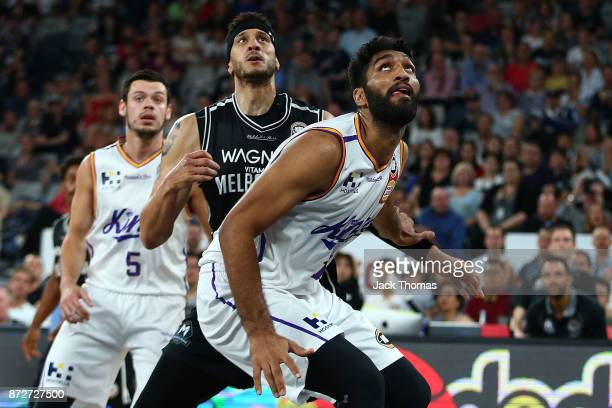 Amritpal Singh of the Sydney Kings and Josh Boone of Melbourne United battle for the rebounds during the round six NBL match between Melbourne United...