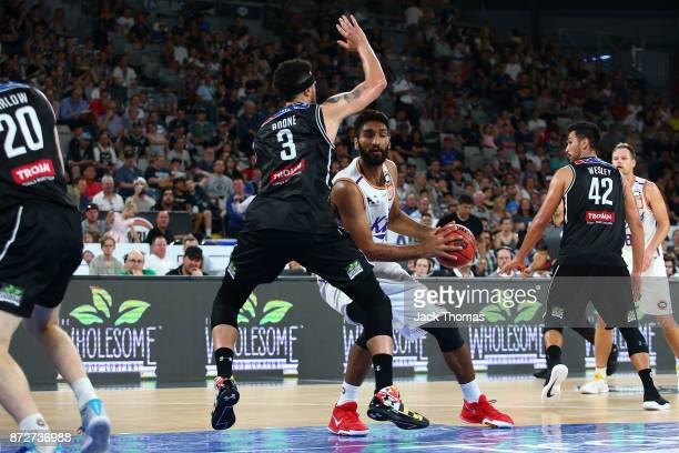 Amritpal Singh of the Sydney Kings looks to shoot against Josh Boone of Melbourne United during the round six NBL match between Melbourne United and...