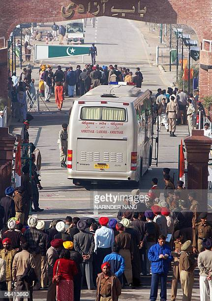 A bus carrying local officials crosses the IndiaPakistan border at Wagah in India's northern state of Punjab 11 December 2005 as part of a trial run...