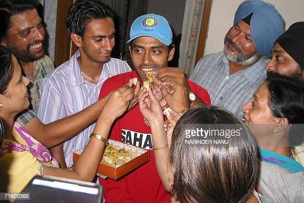 Indian cricketer Tejinder Pal Singh is feted by family members and well wishers at his home in Amritsar10 August 2006 after being selected in a...