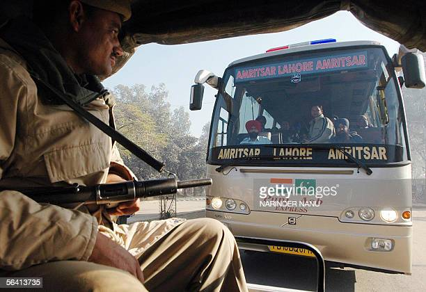 Indian policemen escort a bus carrying local officials on its way to cross the IndiaPakistan border at Wagah in India's northern state of Punjab 11...