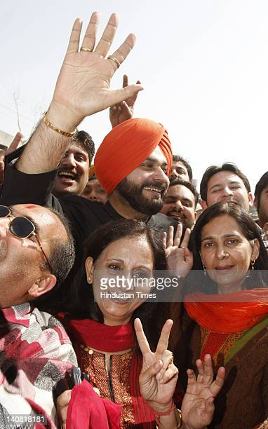 Amritsar MP Navjot Singh Sidhu along with his wife and newly elected BJP MLA from Amritsar east Navjot Kaur Sidhu celebrate the notable performance...