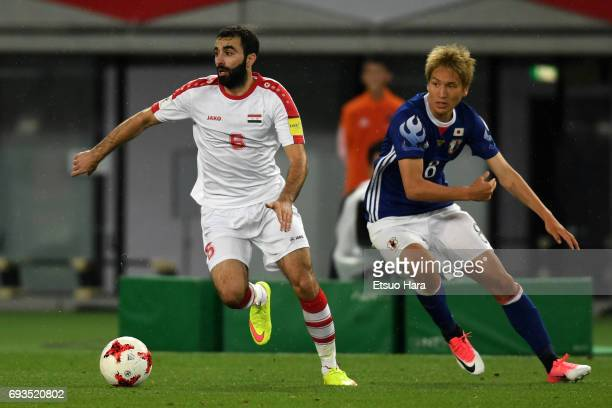 Amro Jeniat of Syria and Genki Haraguchi of Japan compete for the ball during the international friendly match between Japan and Syria at Tokyo...