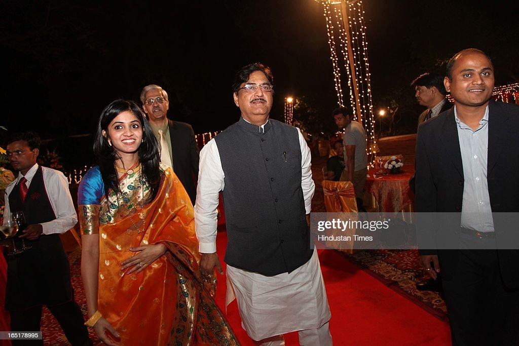 Amruta Yeravdekar with BJP leader Gopinath Munde during the wedding reception of educationist Dr SB Mujumdar's grandson Ameya Yeravdekar and Swati Thorat at Delhi Gymkhana on March 22, 2013 in New Delhi, India.