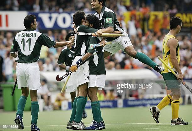 Pakistanis Shabbir Hussain Rehan Butt Shakeel Abbasi Imran Khan Yousafzei celebrate their winning goal against Australia in the final of the...