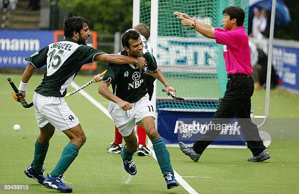 Pakistan's Shabbir Hussain and Pakistans Shakeel Abbasi celebrate their 30 agaisnt Germany during their match of the Rabobank Field Hockey tournament...